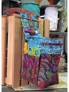 Keep yourself organized while working at your sewing machine with this handy catcher! It's a thread catcher as well as an organizer for practically every notion you need to use as you're stitching up a storm. Best of all, it uses just 2 fat quarters!...