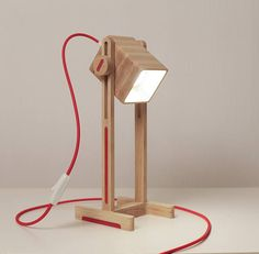 Modern handcrafted desk lamp. Nice gift idea. Simple and functional design. Use the lamp as a faithful friend in the work, resting with a book or simply as a stylish decoration for your home or office..Lamp made ​​of solid wood on unique technology. The original color of the lamp