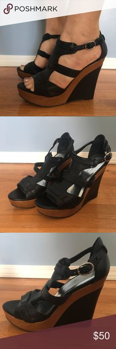 {INC} Wood Wedge Sandals Black and wooden wedge sandals in wonderful condition! Cute strappy look with hook at ankle. Near perfect condition. Some small scuffs on wooden parts and small dents on black wedges. Never been worn outside. INC International Concepts Shoes Wedges