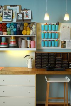 I love the clean whimsy in this craft space.  I think clipboard picture frames are in my near future...