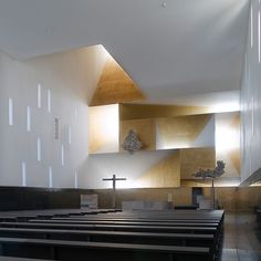 a corten structure that begins with an edge and ends in an iconic explosion of skylights houses church services, administrative offices and living quarters for priests.