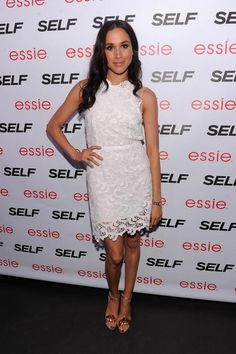 Meghan Markle on Red Carpet wearing a white lace dress by Joy Cioci.  Please check out her Kickstarter campaign.