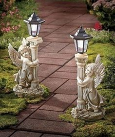 Bring a touch of heaven to your yard with these Solar Angel Garden Lanterns. The lighted garden decor is highly detailed with an angelic look. On a full charge, the lantern turns on automatically at night with up to 10 hours of constant white light. Garden Lanterns, Solar Lanterns, Solar Lights, Path Lights, Angel Garden Statues, Garden Angels, Prayer Garden, Angel Decor, Lawn And Garden