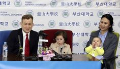 Robert Kelly, left, a political science professor at Pusan National University, holds a press conference with his wife Jung-a Kim, right, and children James and Marion at the university in Busan, South Korea, Wednesday, March 15, 2017. As Kelly speaks from his home office via Skype with BBC about the just-ousted South Korean President Park Geun-hye, his eyes dart left as he watches on his computer screen as his young daughter parades into the room behind him. Her jaunty entrance resembles…