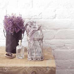 32615714-Rustic-home-decor-provence-style-Lavender-bouquet-of-dried-field-flowers-and-glass-spice-jars-on-woo-Stock-Photo.jpg (1300×1300)