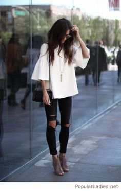 Black pants with cuts, white blouse and nude boots