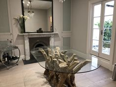 This 8 Seat Natural Driftwood Dining Table has been topped with a Racetrack Glass Top and looks fabulous in it's new home