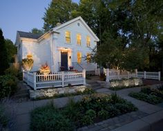 Island Cottage Historic Restoration - TreHus Architects + Interior Designers + Builders