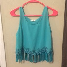 Crop top Super cute crop top with hanging tassle things all round. It's an aqua color fresh material. Used condition Mine Tops Crop Tops