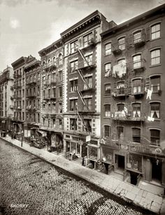 View of Mott Street in New York's Little Italy (now Chinatown) circa 1910. The building in the middle is 156 Mott Street. (8)