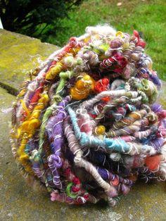 Handspun yarn in every color you can imagine.  http://www.shopneauveau.com