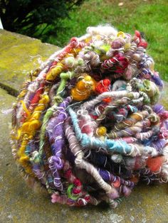 Handspun yarn in every color you can imagine.  http://www.shopneauveau.com