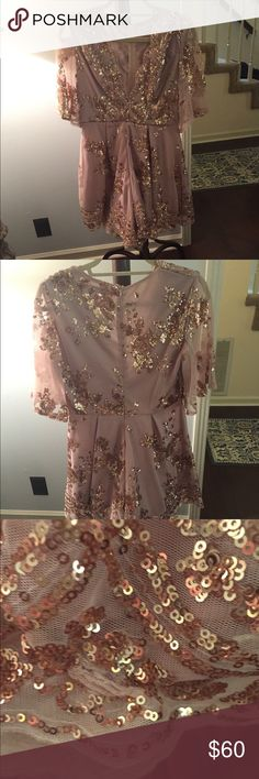 Hello Molly Sequin Romper Hello Molly sequin romper. Color is light mauve with bronze sequins. Romper has a deep V neckline and elbow- length sleeves. Only worn once, sequins are in great shape. Small snag in the fabric on the bottom of the left leg. Hello Molly Other