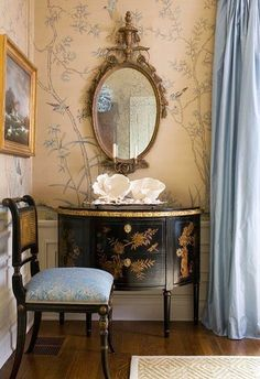 Chinoiserie styled decor featuring white Chinese porcelain and Chinese themed wallpaper.