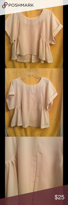 Dress Blouse with style This cream colored flowing crop blouse is alive with character. Lively drape over  short cuffed sleeves with back slit has it all. Dress it up with a skirt or go causal with a pair of jeans, boots and a single strand of peals. Whatever  you do this is a shirt of distinction. It was bought in a trendy Boutique so there are not many around. I've worn it several times and it is in good condition. Tops Crop Tops