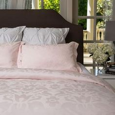 Three-piece 100% cotton jacquard bedding set with damask motifs. Includes one duvet and two shams.   Product: Full/Queen: 1 Duvet cover and 2 standard shams  King/California King: 1 Duvet cover and 2 Euro shams Construction Material: 100% Cotton sateenColor:  PinkFeatures:  350 Thread countJacquard designDuvet zipper enclosure Interior corner tiesNote: Shams do not include insertsCleaning and Care: Machine wash cold