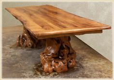 Amazing mesquite dinning room table with natural edge and Burl stump bases  <3