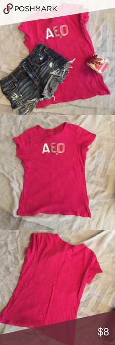 American Eagle Outfitters AEO Hot Pink Tee💓. Very cute with the different AEO Embroidered on front🎀... Has small pin hole on back at the very top as shown in last pic and unless hair is very short but still very minor and small😉. Says extra large but fits more like medium American Eagle Outfitters Tops