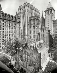 "New York circa 1915. ""Trinity Church and office buildings."" Rising heavenward at center, the twin slabs of the Equitable Building; at right, the pyramid-topped Bankers Trust tower."
