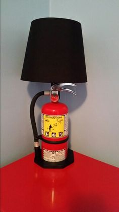 Fire extinguisher lamp. My hubby made for our son. Awesome accent to his fireman room!!