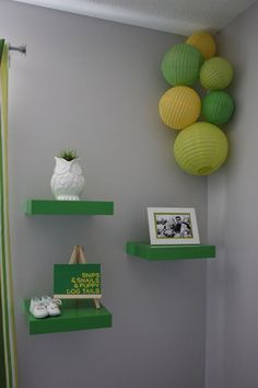 a soft but modern grey and a bold green, ikea shelves (saw them on sale/discontinued?)