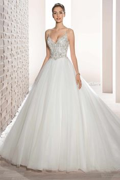 Demetrios Wedding Dress -Style 723 : Shimmering beaded embroidery and a luxurious tulle skirt create this stunning ball gown with v-neckline, low v-back and chapel length train.