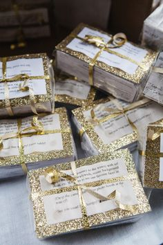 glitter-wrapped cameras for guests (or favors!), photo by Izzy Hudgins http://ruffledblog.com/glitzy-bohemian-ny-wedding #packaging #gold