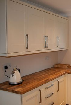 Love this oak block worktop with the shaker style units.