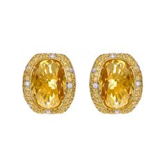 A vibrant and cheerful pair of bespoke cut Citrine earrings, bordered by a cluster of yellow sapphires and brilliant cut diamonds, mounted in 18ct yellow gold