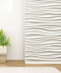 A white textured wall against a plain wall.