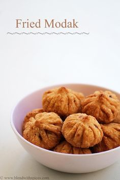 Fried Modak Recipe - Deep fried dumplings with sweet coconut filling - step by step #recipe - Ganesh Chaturthi / Vinayaka Chavithi Recipes - blendwithspices.com