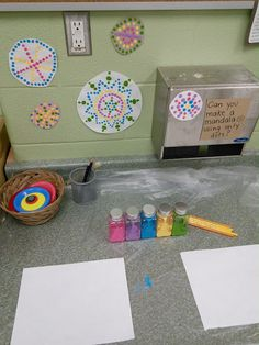 Make a Mandala as inquiry about art and what it means to be an artist. Here using dots (pencil erasers) Lots of good prep ideas with manipulative - buttons, pattern blocks, play dough. Go to the site for more