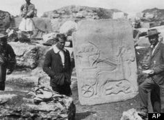 In this image made available by the Joint Turco-Italian Archaeological Expedition, in this 1913 file photo, a young T.E. Lawrence (of Arabia), left, and C.L. Woolley pictured in front of the Long Wall of Sculpture at Karkemish in Gaziantep province, Turkey.