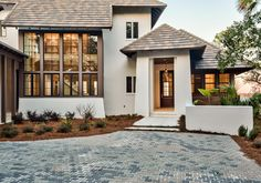 Home Exterior. Home Exterior Entry. The entry features a French Quarter Lantern on a Yoke Bracket by Bevolo. Home Exterior Entry Ideas. Casey Joiner - Luxury Homes Luxury Homes Exterior, Modern Exterior, Exterior Design, Florida Homes Exterior, Cafe Exterior, Stucco Exterior, Grey Exterior, Waterfront Homes For Sale, House Paint Interior