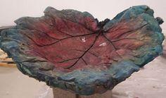 Birdbath made from a rhubarb leaf and concrete.  Gorgeous!