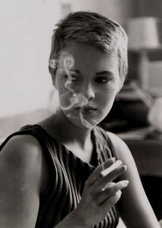 If this isn't the best advert for smoking, I don't know what is. Raymond Cauchetier photographs Jean Seberg on the set of Breathless.