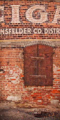 Old brick and window all shuttered up