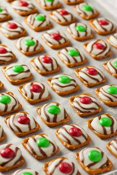 This fun, EASY Christmas Treat Recipe is sure to be a hit! With ONLY 3 ingredients, you can whip up these Pretzel M&M Hugs for gifts or to add to your Christmas Cookie Trays! Visit our 100 Days of Homemade Holiday Inspiration for more recipes, decorating ideas, crafts, homemade gift ideas and much more! #christmaspartyideas