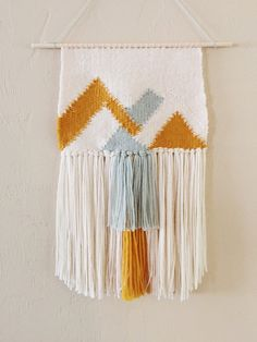 This tapestry is a made-to-order piece measuring 12 inches across and 20 inches to the bottom of the fringe and hangs on a wooden dowel. Since this item
