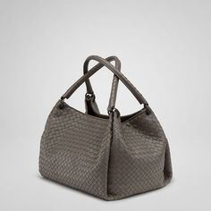 """With its in-set woven handle, pleated sides and rectangular shape, wear this roomy intrecciato bag over the shoulder or on the crook of your arm and add timeless elegance to every look. 12.6"""" W x 10.2"""" H x 8.7"""" D"""