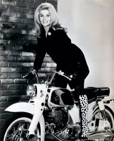 Ann Margret on her Honda