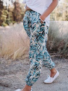 Keep it light and breezy with our palm printed jogger pants. Featuring side pockets, feel free to dress them up or down and lounge all day with their loose and comfy fit. *Includes a free randomly sel