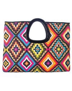 ESSENTIALS Tribal print large clutch bag All over print colorful design Leather handle Dual snap closure Interior cell phone and zip compartments