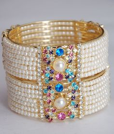 Set Of Two Designer Ladies Bangles Of Latest Fashion Studded With Sparkling And Shining Stones & Pearls All Over.