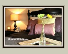 Bedroom: mirror w flowers in vase on bed; coffee mug on coaster or fabric napkin