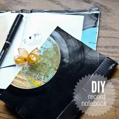 Vinyl Record Notebook DIY. I think this is a GREAT idea, but her method of binding hurts my soul a little bit. BUT good to know that if you heat up a record in the oven you can cut it with scissors: I had no idea!