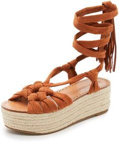 soft suede and built with a jute-wrapped platform. Fringed, wraparound ties. Sigerson Morrison Cosie Flatform Sandals