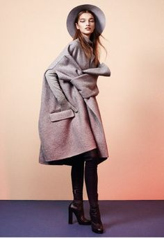 Fashion by Charlie Harrington. Photographs by Jan Lehner  Grey double-faced cashmere coat and blue leather boots by Céline; grey lambswool roll-neck jumper and grey cashmere gloves by Johnstons of Elgin; grey rollable fur-felt hat by Helen Kaminski.