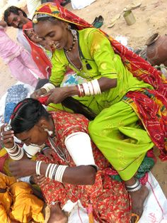 Braiding at Pushkar Fair, regarded as one of the largest camel festivals in the world - INDIA