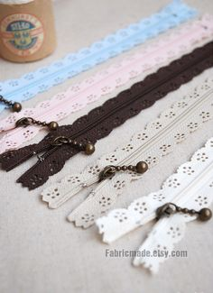 Love these lacy zippers. SHORT Zipper - Cream Scallop Lace Clothes Purse Bags Metal Zipper 5's - 8 Inches. $6.20, via Etsy.